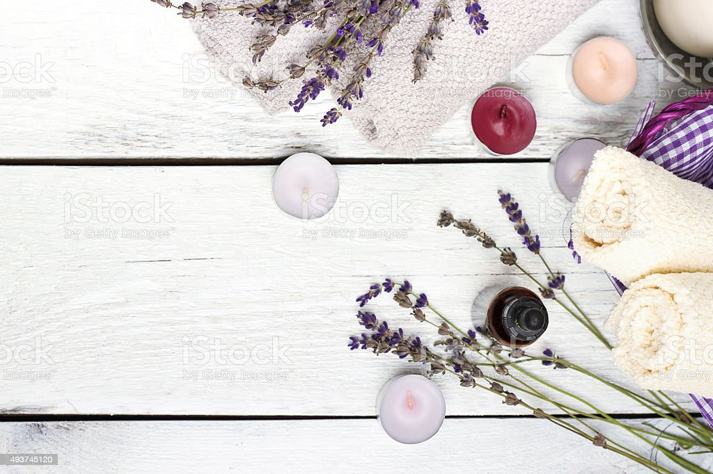 Dry lavender and oil  on a white wooden table stock photo