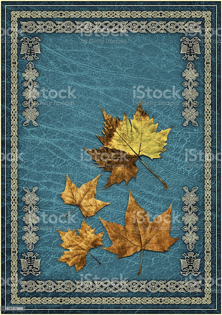 Dry Maple Leaves Isolated on Blue Ornate Gilded Parchment Background royalty-free stock photo