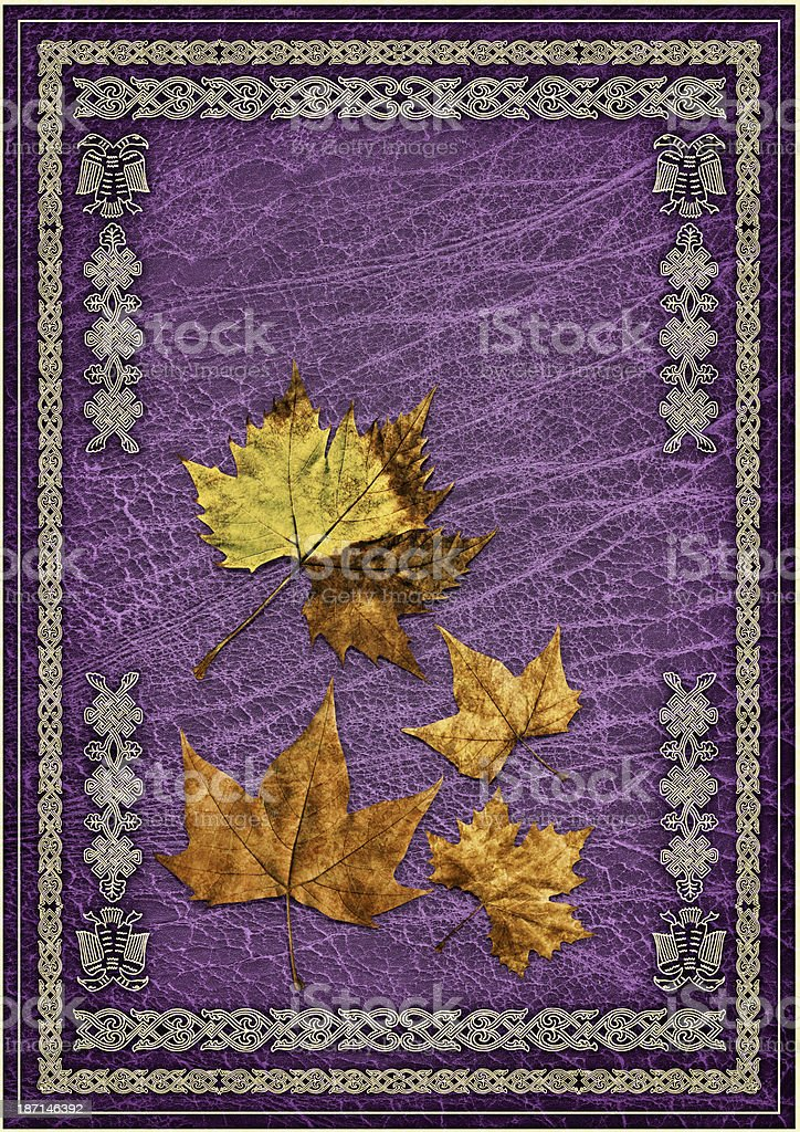 Dry Maple Leaves Isolated on Purple Ornate Gilded Parchment Background royalty-free stock photo