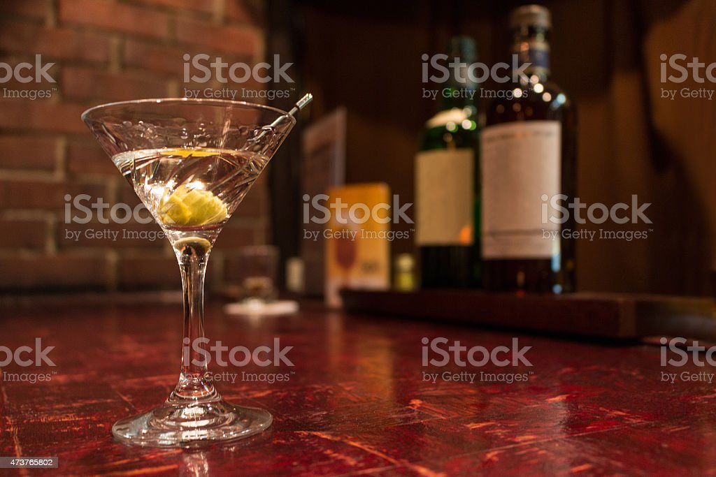 Dry martini in a glass on a bar counter stock photo