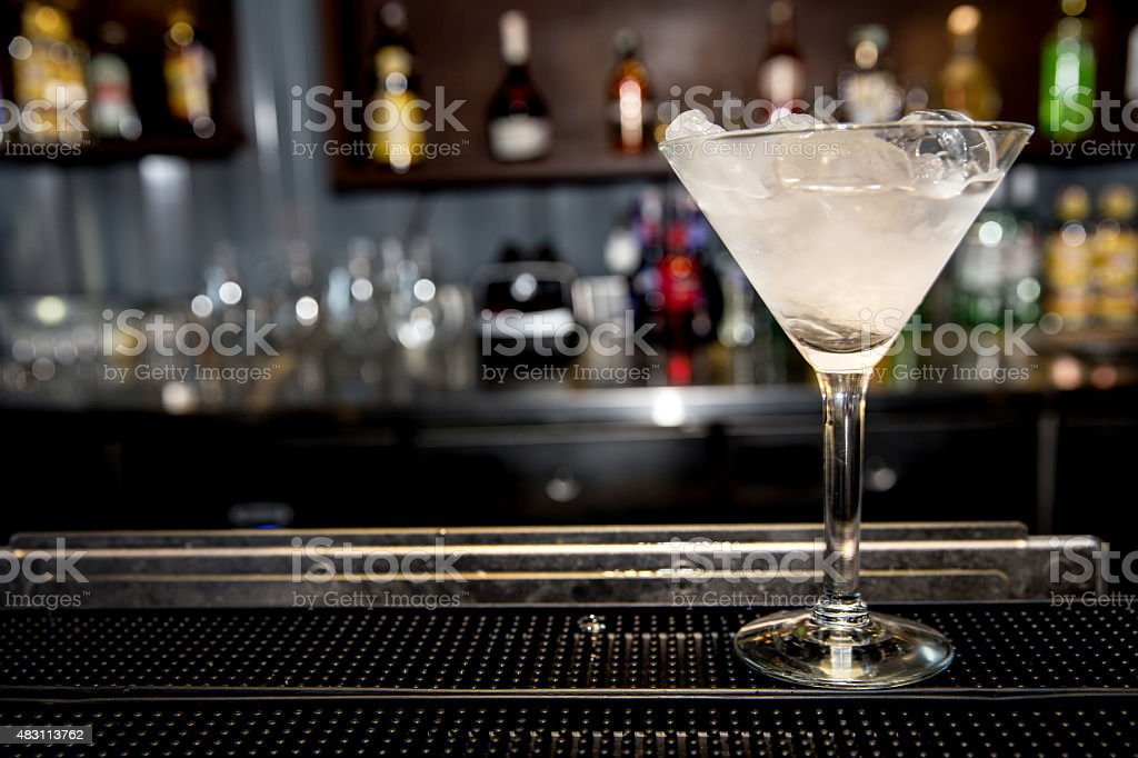 Dry martini on bar stock photo