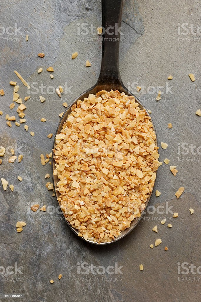 Dry Minced Garlic in Spoon stock photo