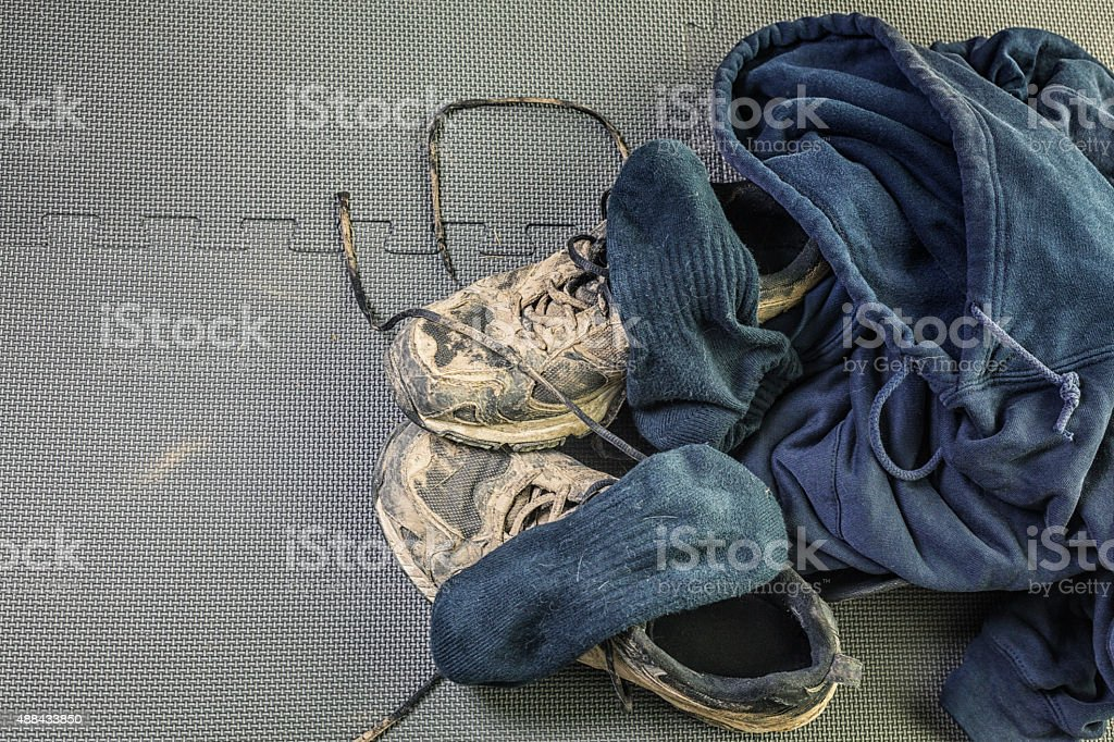 Dry Mud Running Sneakers Pile of Workout Clothes stock photo