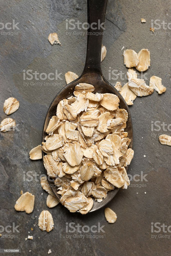Dry Oatmeal Flakes in Spoon royalty-free stock photo