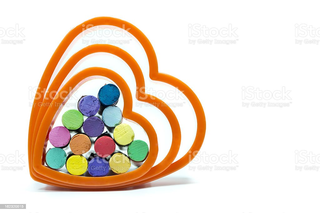 Dry oil pastels inside of the heart shape royalty-free stock photo