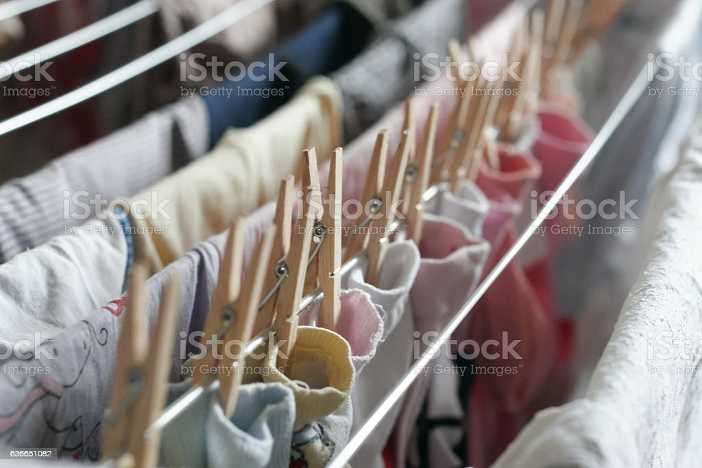 Dry on a rope baby socks stock photo
