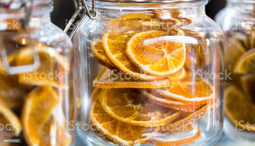 Dry orange slices in glass jar. stock photo