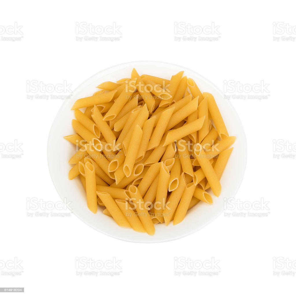 dry pasta in plate (isolated on white) stock photo