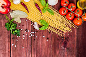 Dry pasta with tomatoes, herbs and spices for tomato sauce