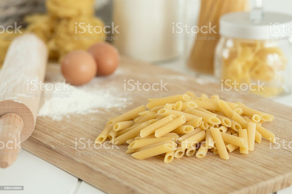 Dry penne ready to cook stock photo