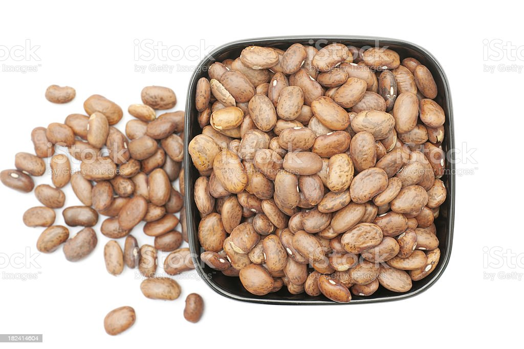 dry pinto beans in bowl stock photo