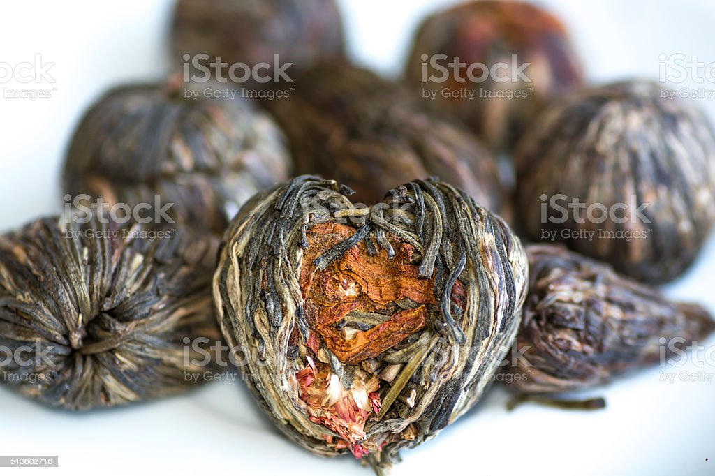 Dry Pressed leaf tea with flowers stock photo
