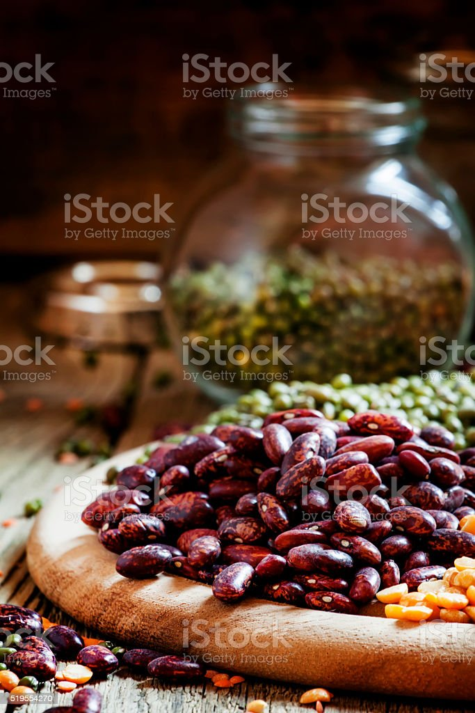 Dry purple beans, bean mix on plate stock photo