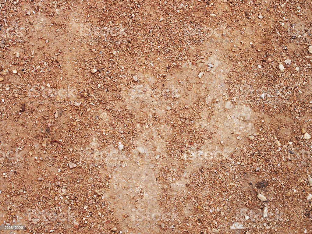dry red clay with stones textured background stock photo