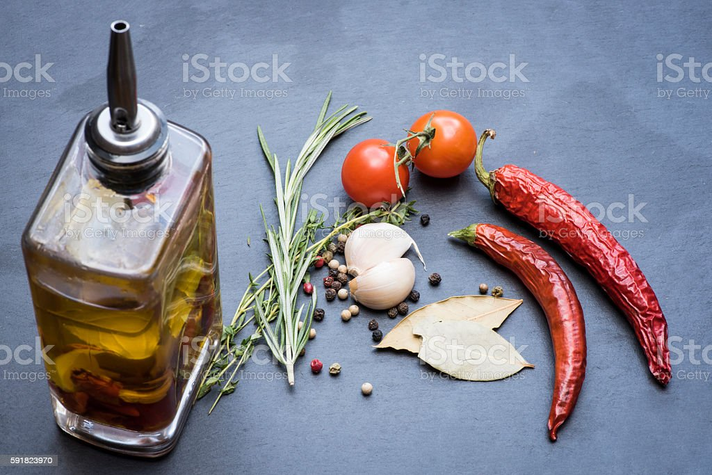 Dry red hot chili peppers, tomatoes, garlic and seasoning stock photo