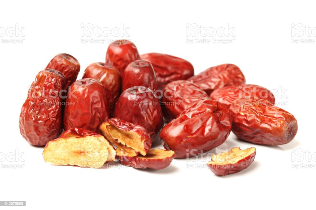 Dry red jujubes  close up on white background stock photo