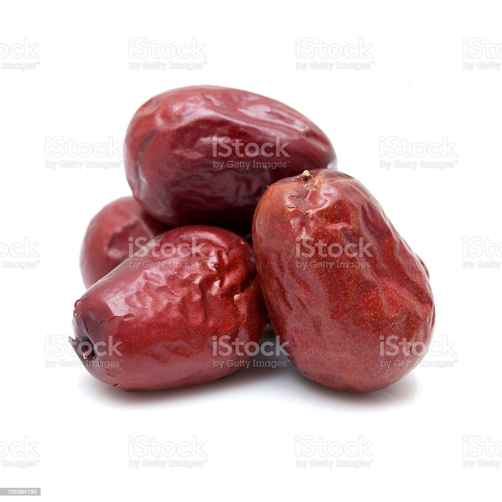 Dry red jujubes isolated on white background stock photo