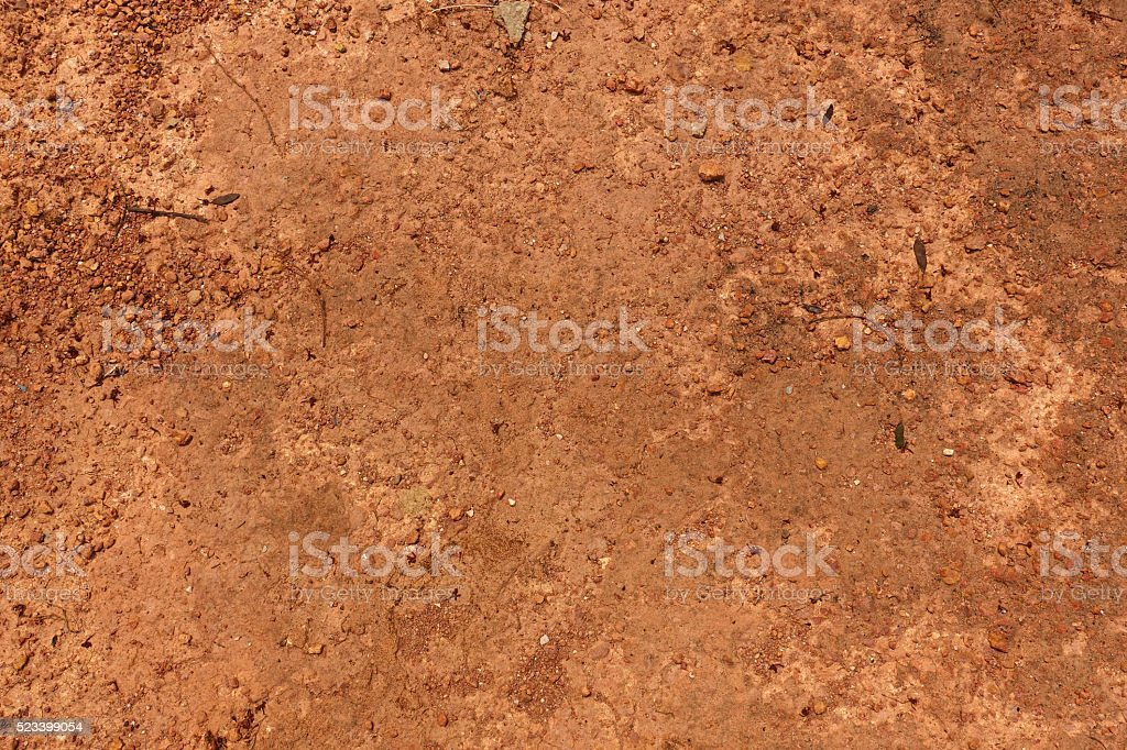 Dry red soil and small rock in Thailand. stock photo