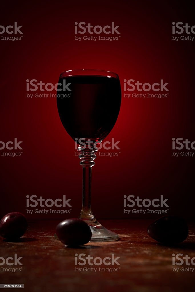 dry red wine and some grapes stock photo