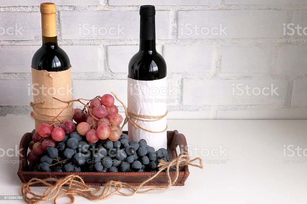 Dry red wine, bunch of dark red and purple grapes stock photo