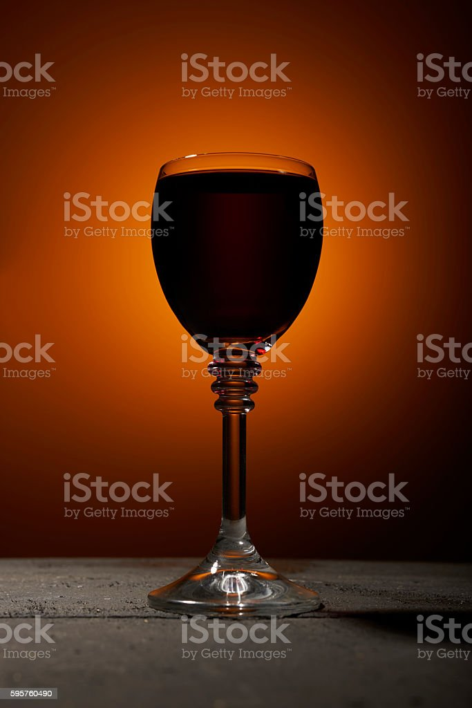 Dry red wine on an orange background stock photo