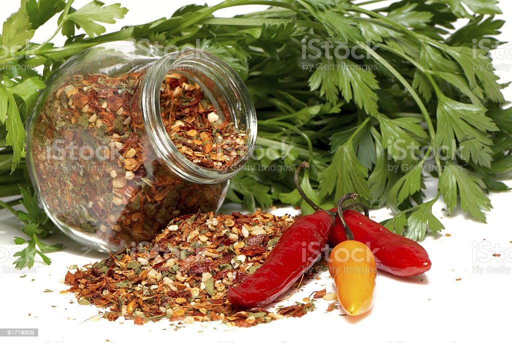 Dry seasoning with chillies and parsley stock photo