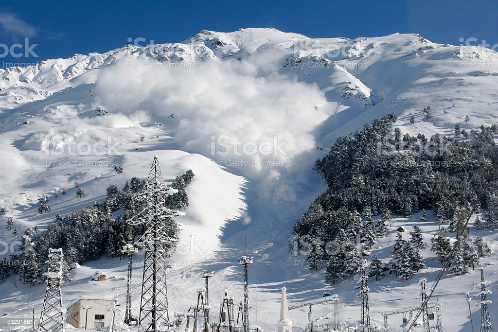 Dry snow avalanche with a powder cloud.Caucasus. stock photo