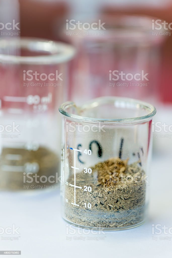 Dry soil in beaker stock photo