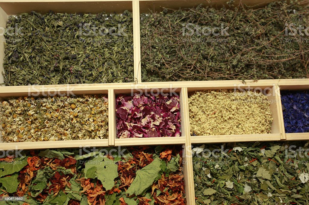 Dry spice and tea in a wooden compartments stock photo