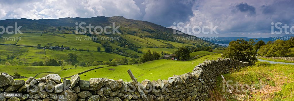 Dry stone wall and mountain farm royalty-free stock photo