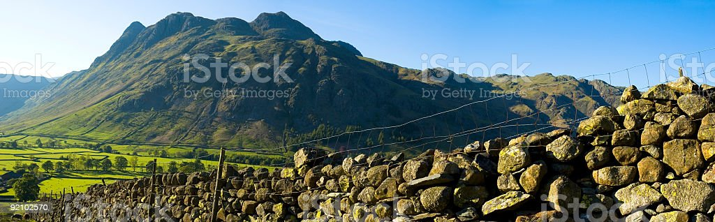Dry stone wall and mountain royalty-free stock photo