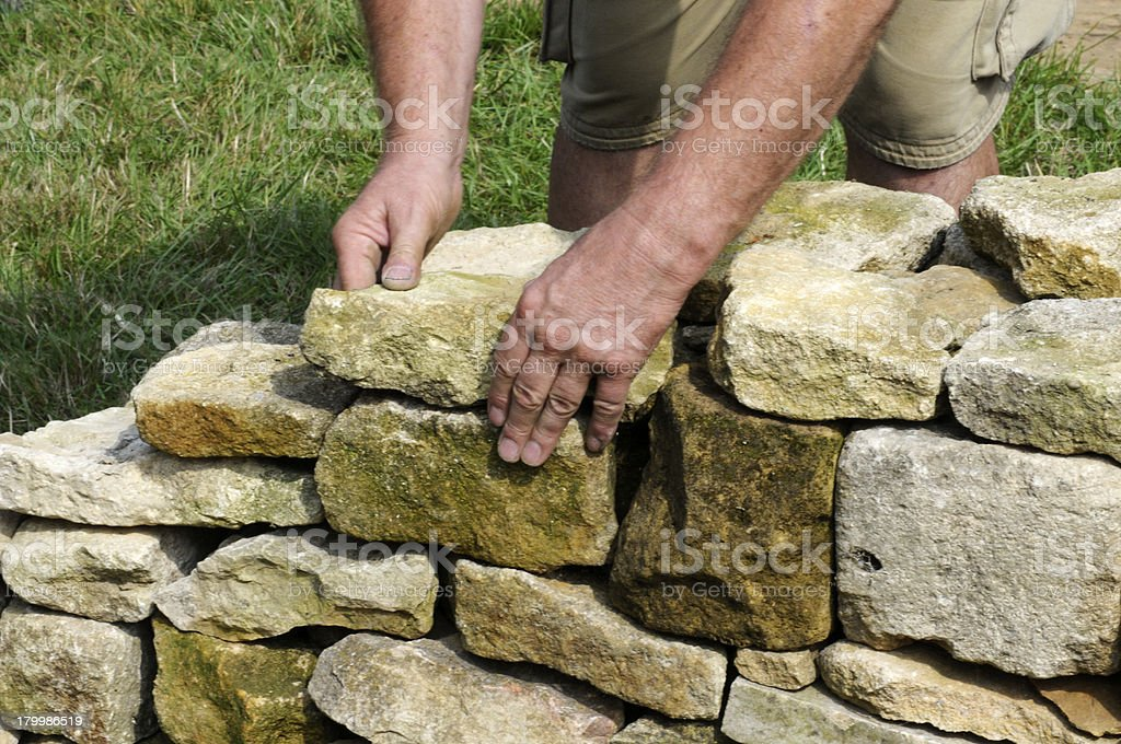Dry Stone Wall Building royalty-free stock photo