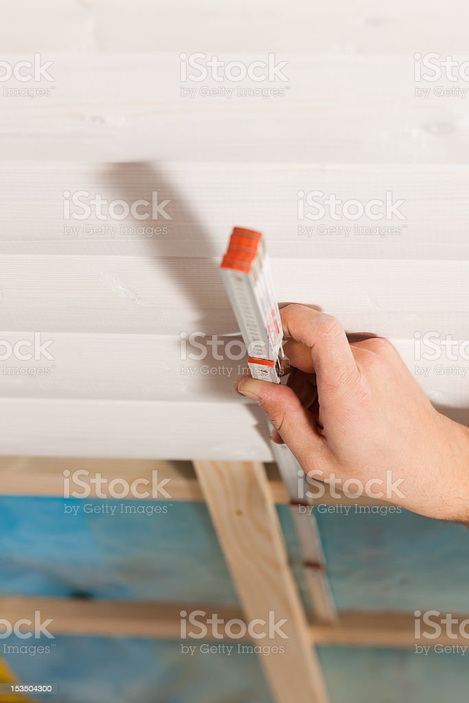 Dry waller measuring with folding rule stock photo