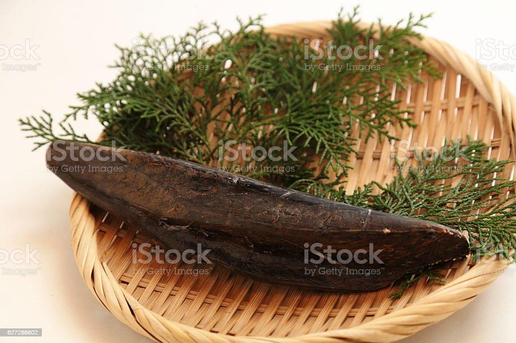 Dry whole katsuobushi ingredient of dashi (japanese soup stock) stock photo