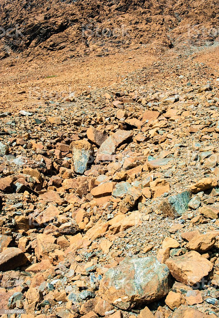 Dry yellow broken rocks on mountain slope stock photo