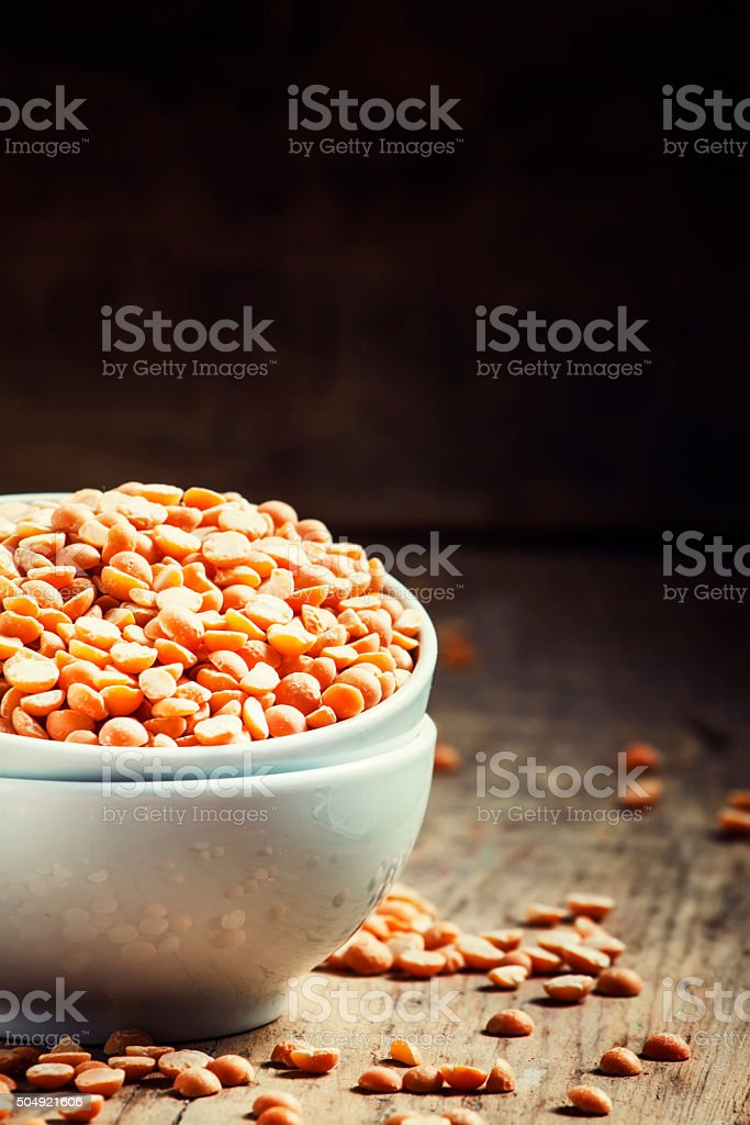 Dry yellow peas in a white porcelain bowl stock photo