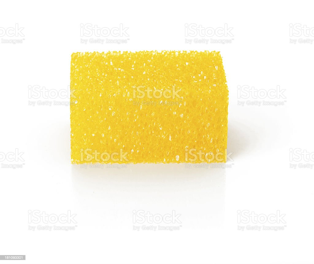 Dry yellow sponge against white background royalty-free stock photo