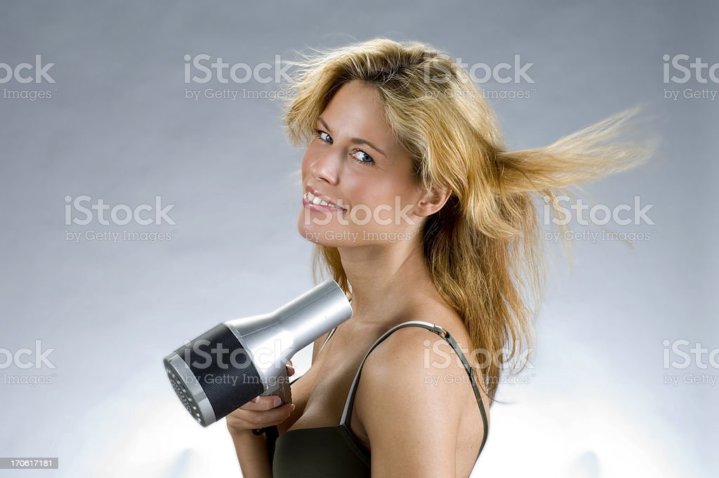drying a lot of blond hair royalty-free stock photo