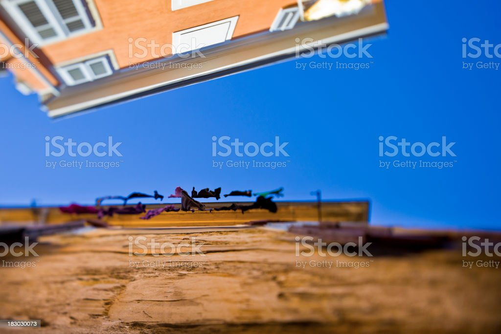 Drying clothes in old Mediterranean street royalty-free stock photo