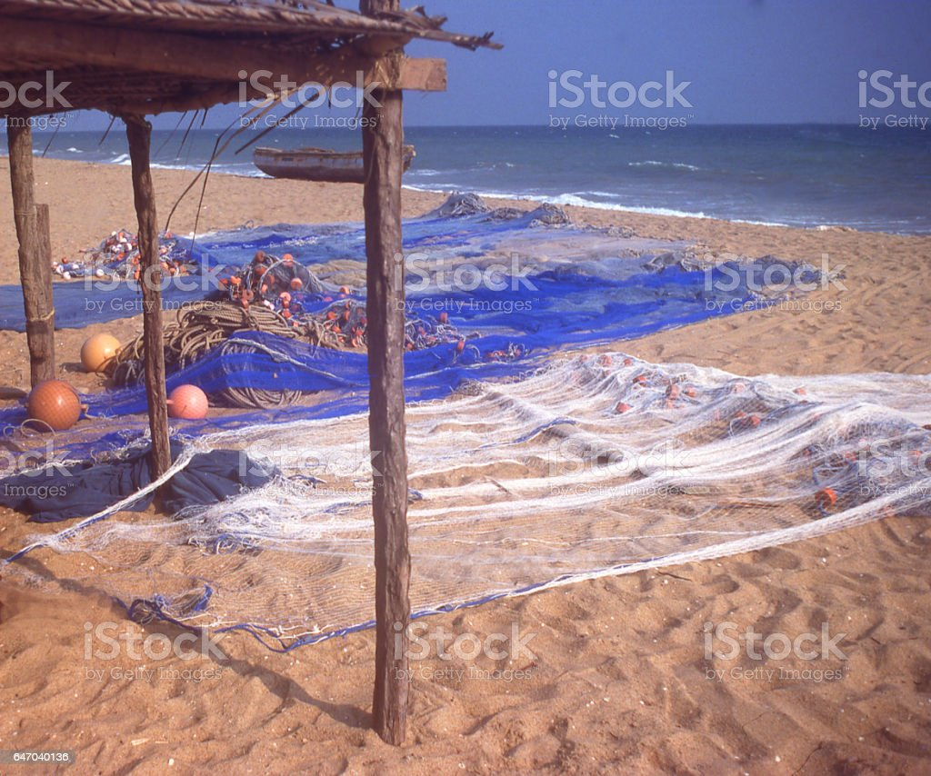 Drying fishing nets along beach area outside Lome Togo Africa stock photo