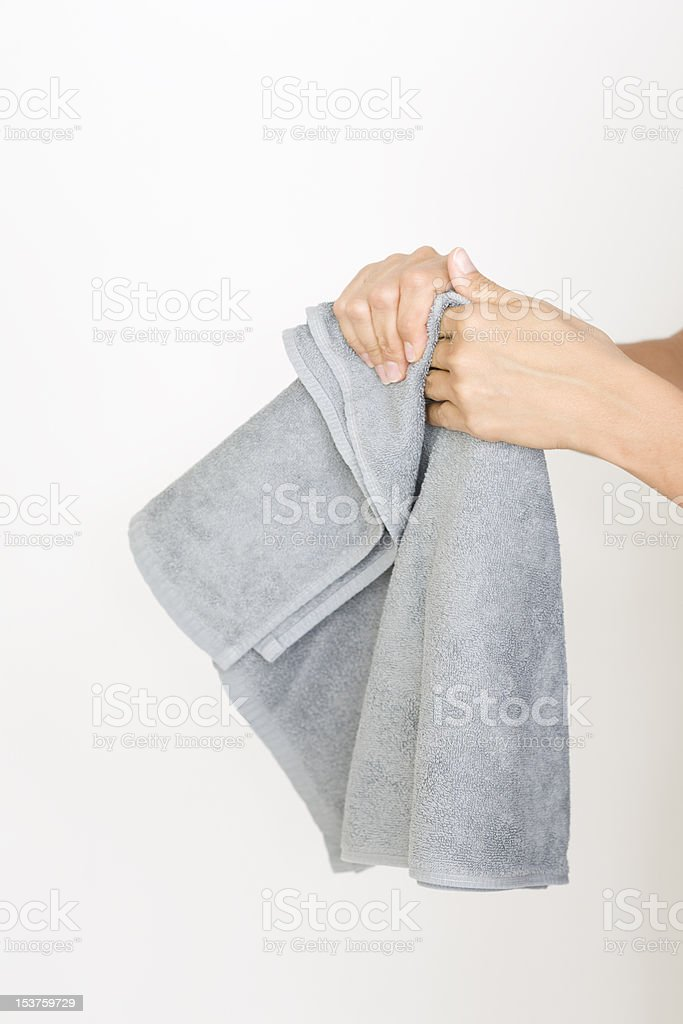 Drying hands with a towel stock photo
