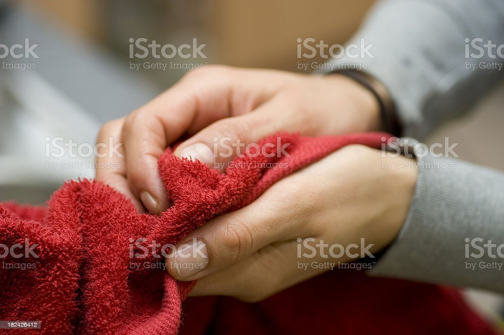 drying hands with towel stock photo