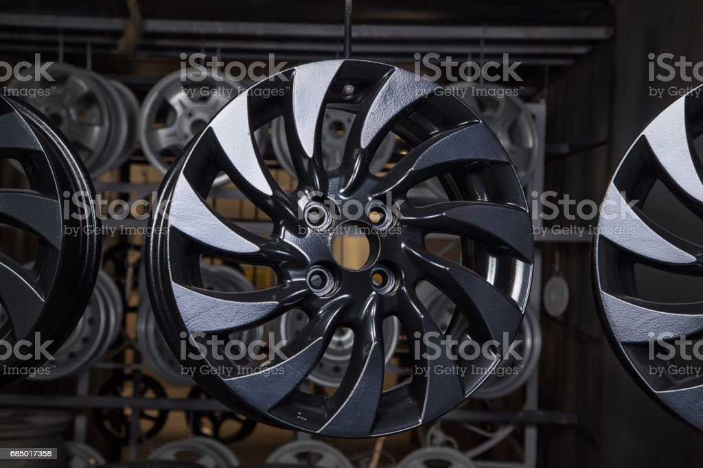 Drying of black disks after powder coating stock photo