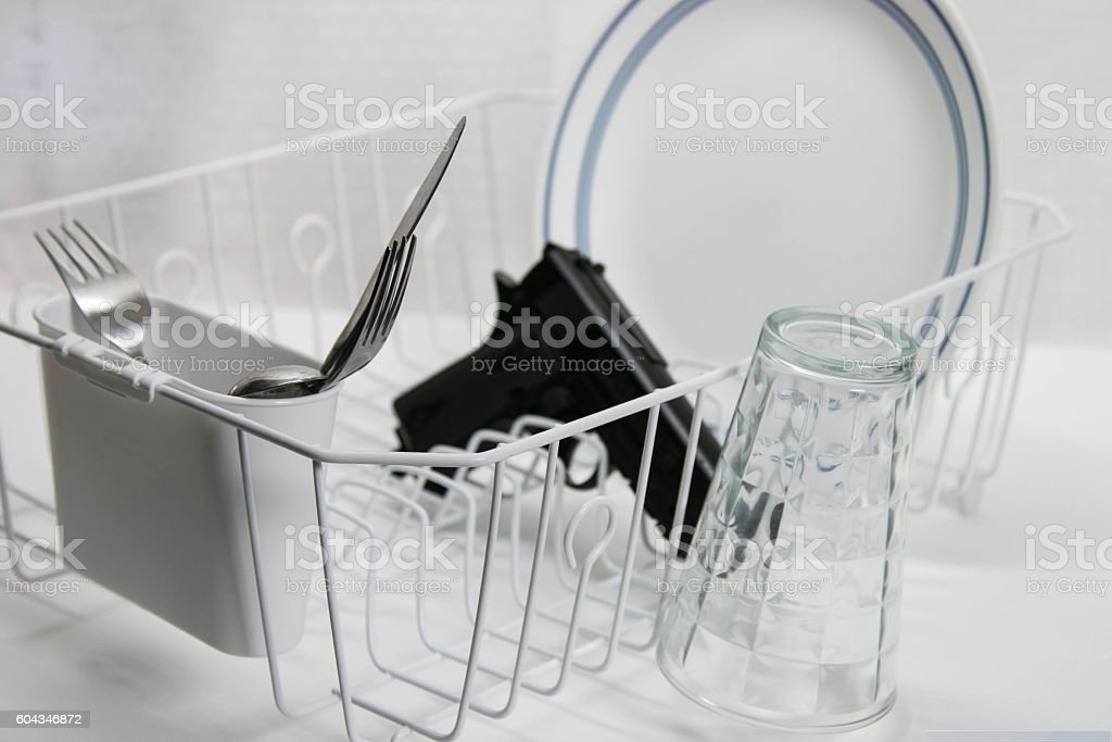 Drying Rack with Gun in it stock photo