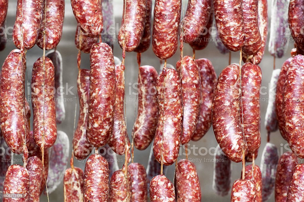 Drying sausages hanging from ceiling stock photo