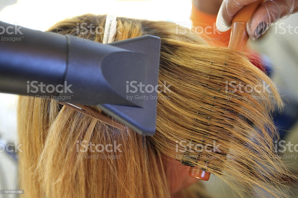 Drying the hair in a coiffeur royalty-free stock photo