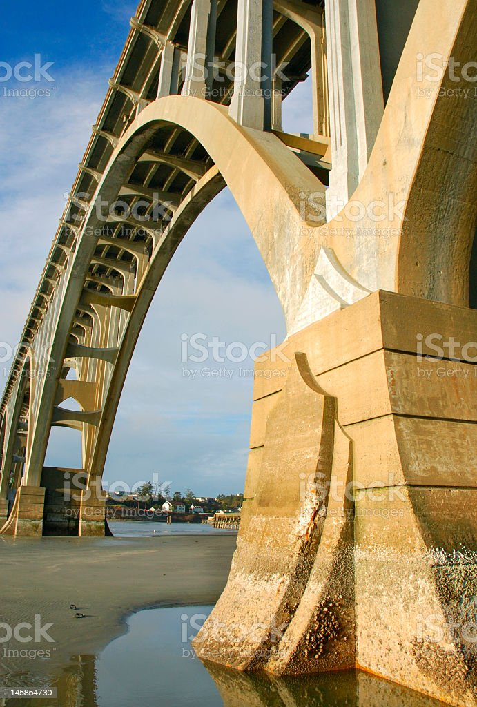 Drying water at base of Roman bridge in urban area of city royalty-free stock photo