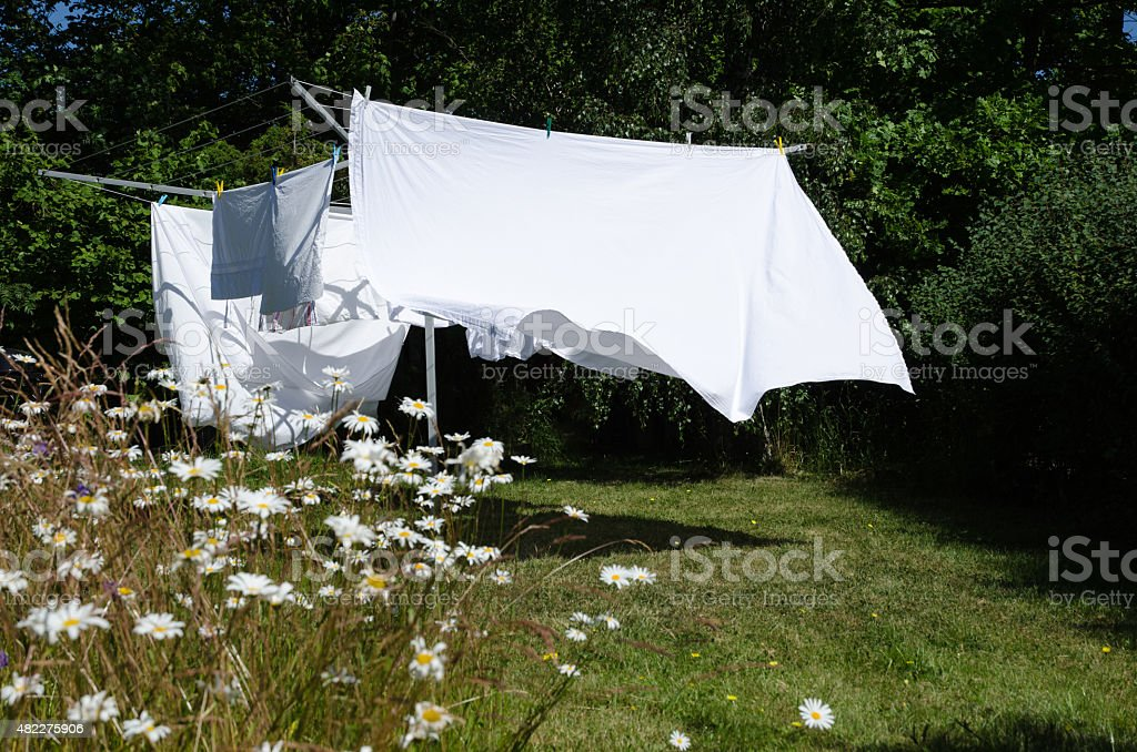 Drying white sheets stock photo