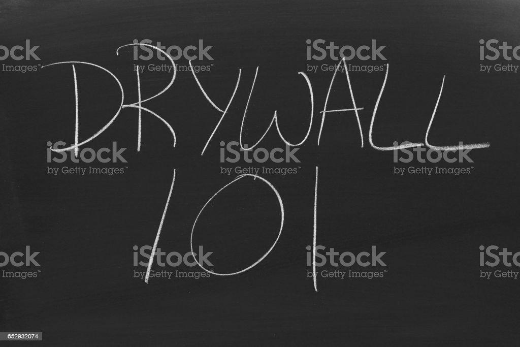 Drywall 101 On A Blackboard stock photo