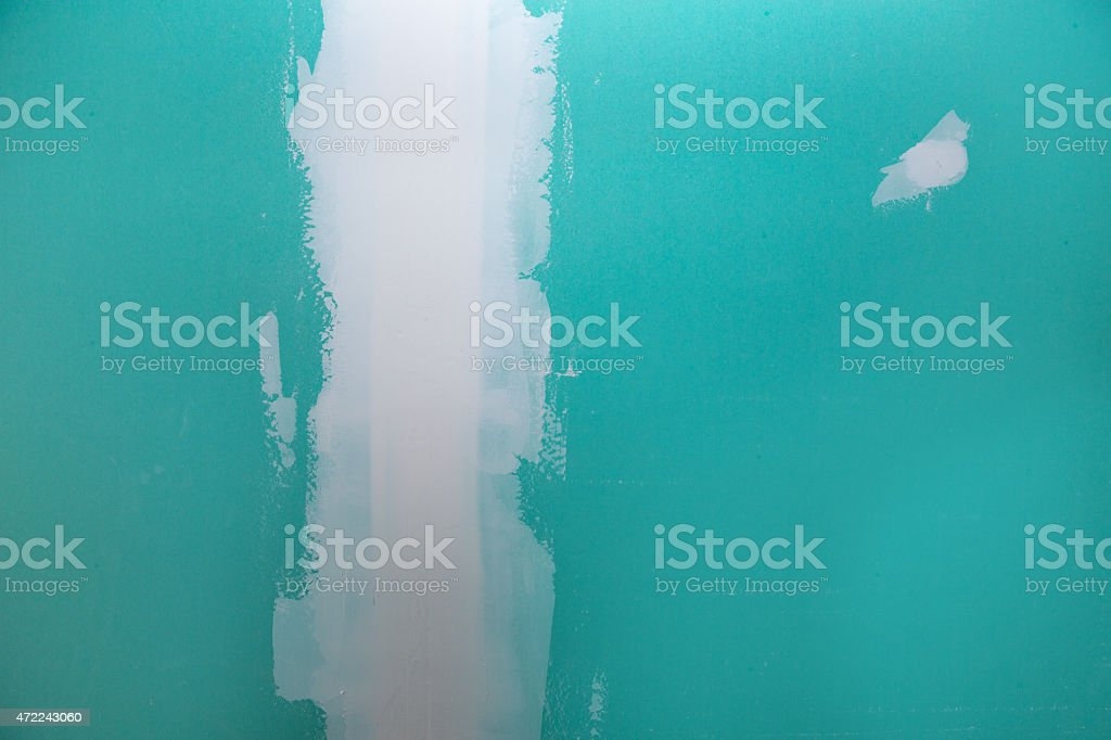 drywall hydrophobic plasterboard in green plaste seam stock photo
